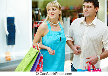 Consumers - Handsome man with paperbags and his girlfriend...
