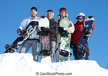 Group of snowboarders - Portrait of happy company of guys...