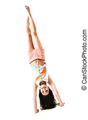Pose - Pretty girl standing upside down in isolation