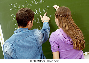 Explanation of formula - Back view of guy pointing at...