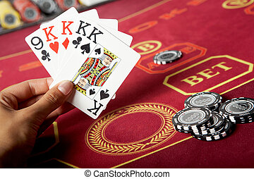 Cards in hand - Image of five game cards in hands with black...