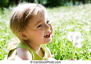Child with flowers - Image of cute girl with white...