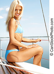 Girl on yacht - Portrait of blonde woman spending time on...