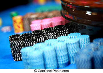 Casino chips - Lots of casino chips on table