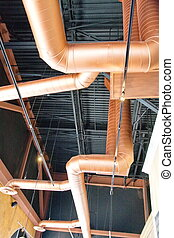 Copper Ducts Under Black Ceiling - Copper ductwork running...