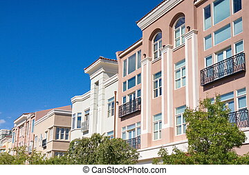 Pink Stucco Buildings with Black Iron Railings - Pink and...