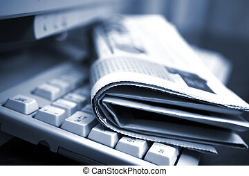 Online news - Newspapers on the computer keyboard close up