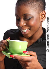 Green cup of tea with a smile - Beautiful smiling black...