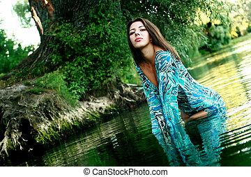 Beautiful girl bathing in a lake