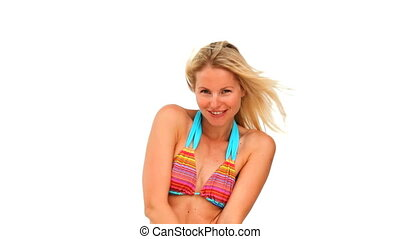 Cute blond woman in swimsuit against a white background