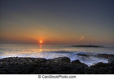 breathtaking sunset over doolin beach, county clare, ireland
