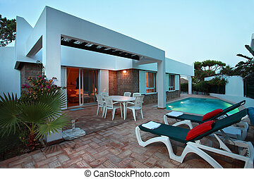 Outdoors - A modern residence with a swimmingpool -...