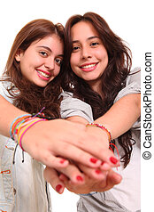 Frienship - Friends holding their hands in signal of...