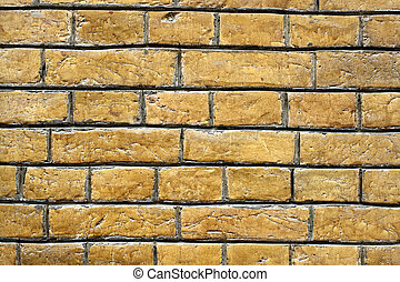 Yellow brick wall background close up