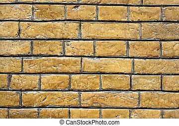 Yellow brick wall background close up