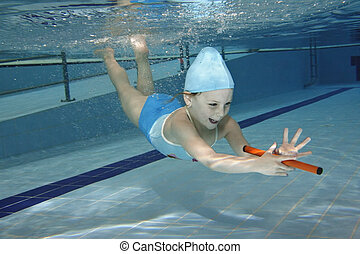 swimming - Underwater picture of a young girl in the...