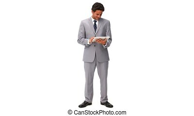 Elegant business man using a touch pad isolated on a white...