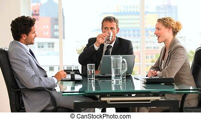 Threesome of business people at an office