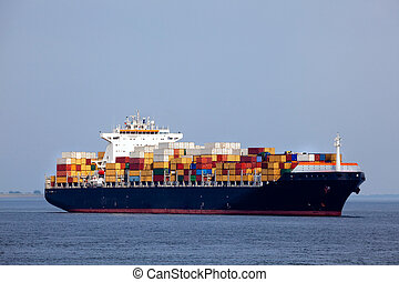 Huge container ship passing - all brand names removed from...