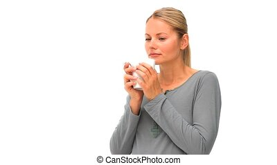 Casual woman drinking a cup of coffee isolated on a white...