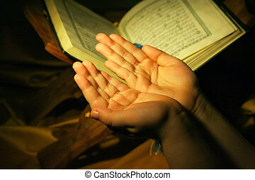 Worshiping hands pray and holy koran