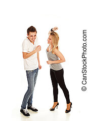 Young woman giving a punch to her boyfriend