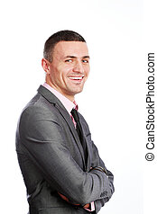 Portrait of a handsome young happy businessman in suit over...