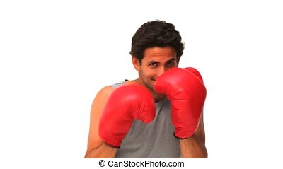 Handsome man with red boxing gloves isolated on a white...