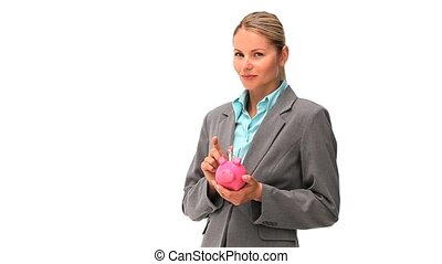 Cute business woman saving up money on a piggy bank isolated...