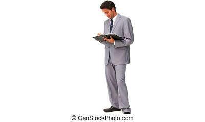 Elegant businessman taking notes isolated on a white...