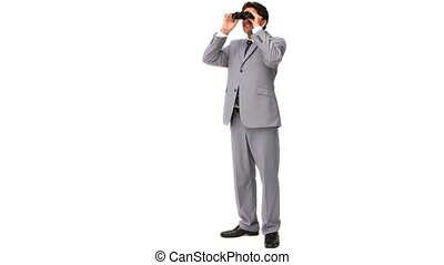 Elegant businessman looking at something with binoculars