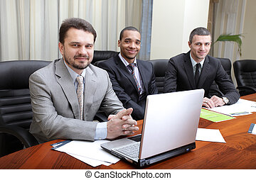 Multi ethnic business team at a meeting. Interacting