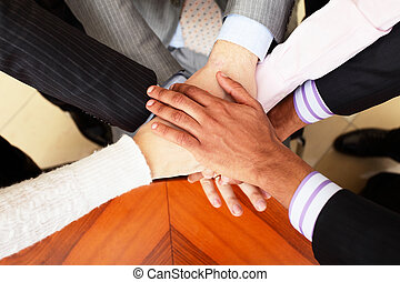 Image of business people hands on top of each other View...