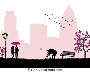 Lovers and photographer background - Lovers in a city park...