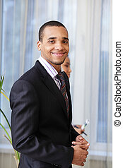 Portrait of a happy African-American young businessman...