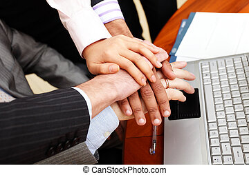 Image of business people hands on top of each other.