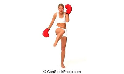 Blonde woman with red boxing gloves isolated on a white...