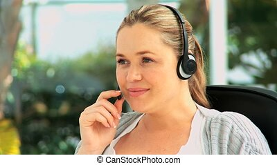 Cute woman with an headset at her desk