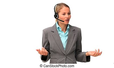 Business woman in gray suit speaking over the headset