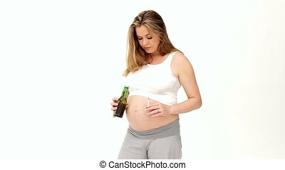 Expecting woman holding a beer and cigarette isolated on a...