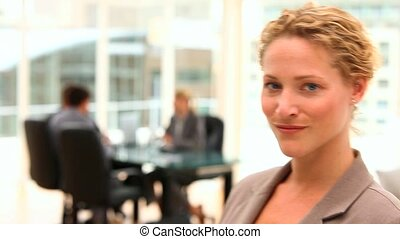 Beautiful business woman looking at the camera with business...