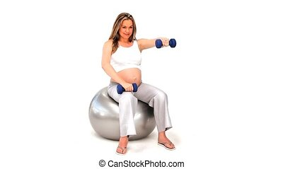 Cute blonde woman doing exercise with dumbbells on a gym...