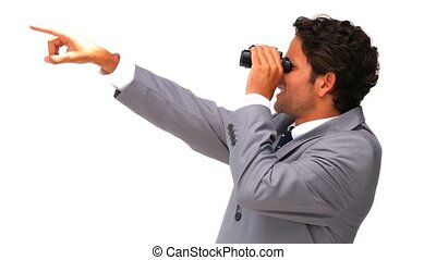 Young business man with binoculars isolated on a white...