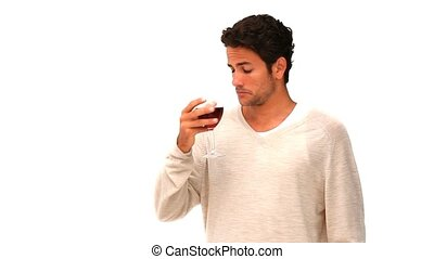 Casual man drinking a glass of red wine isolated on a white...