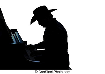 Cowboy Pianist Silhouette - Silhouette of a cowboy paying...