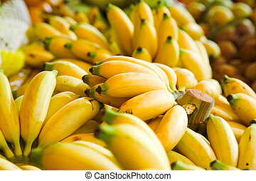 bananas - bunches of yellow babanas on the market