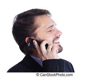 Mature businessman laughing on cellphone