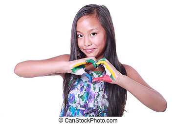 Beautiful asian girl showing a heart with her painted hands...