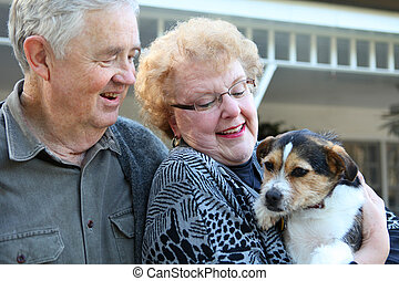 Elderly Couple with Dog - An upbeat joyful elderly man and...