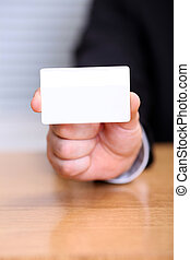 Closeup of business man holding a blank business card